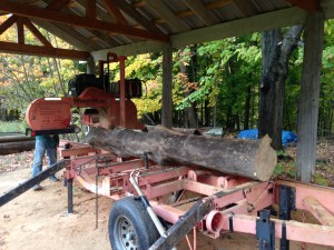 Ash tree section on portable sawmill table at Shupe Homestead being cut into boards