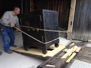 Bill Nahorn, Museum Trustee and head of building and maintenance, works to unload the safe at the Museum property.