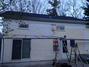 Half of the back of the Shupe House is scraped and primed.
