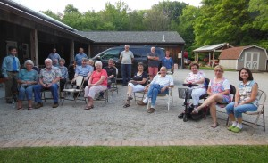 Folks gathered during the grist stone dedication.