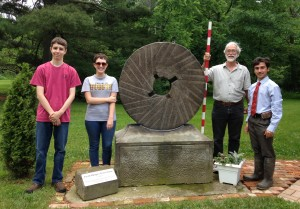 Dr. Hannibal (holding measuring stick) and his team from the Cleveland Museum of Natural History visit the Historic Shupe Homestead to study the Jacob Shupe Griststone.  Col. Nahorn joined in the photo as well.