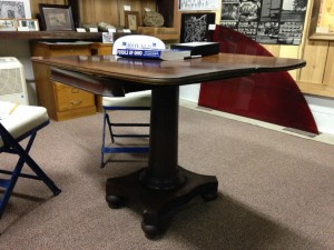 Antique game table at the New Indian Ridge Museum.