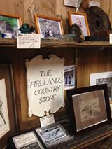 The Firelands Country store plaster sign, made in 1968, now a part of a new display at the Museum.
